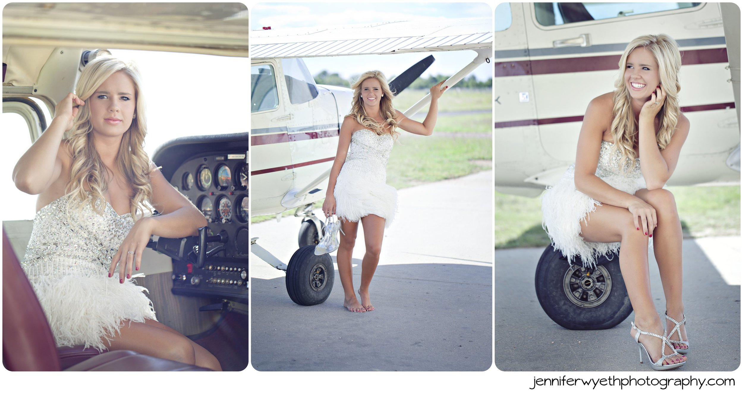 white feathered prom dress wearing girl sits on wheel of an airplane