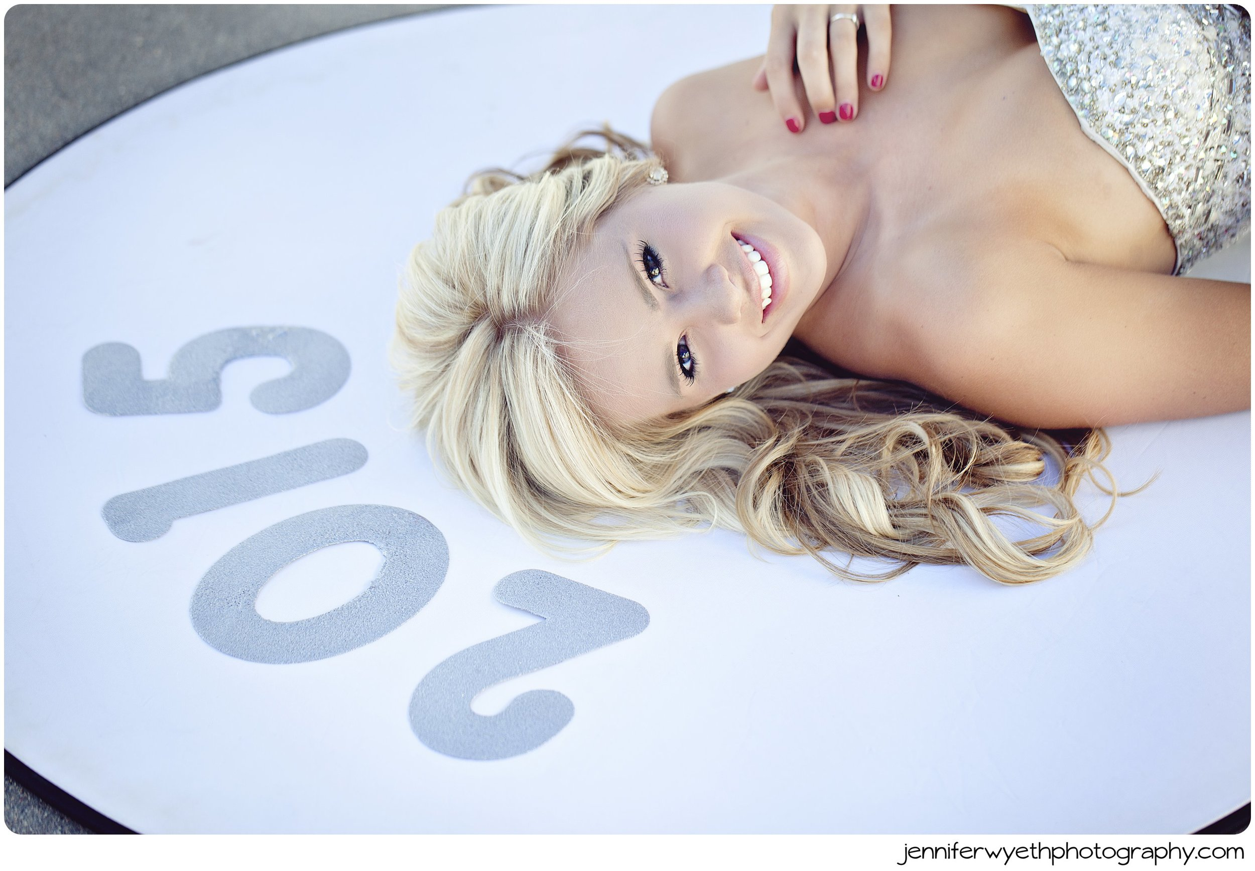 blond teen girl laying down with 2015 sign