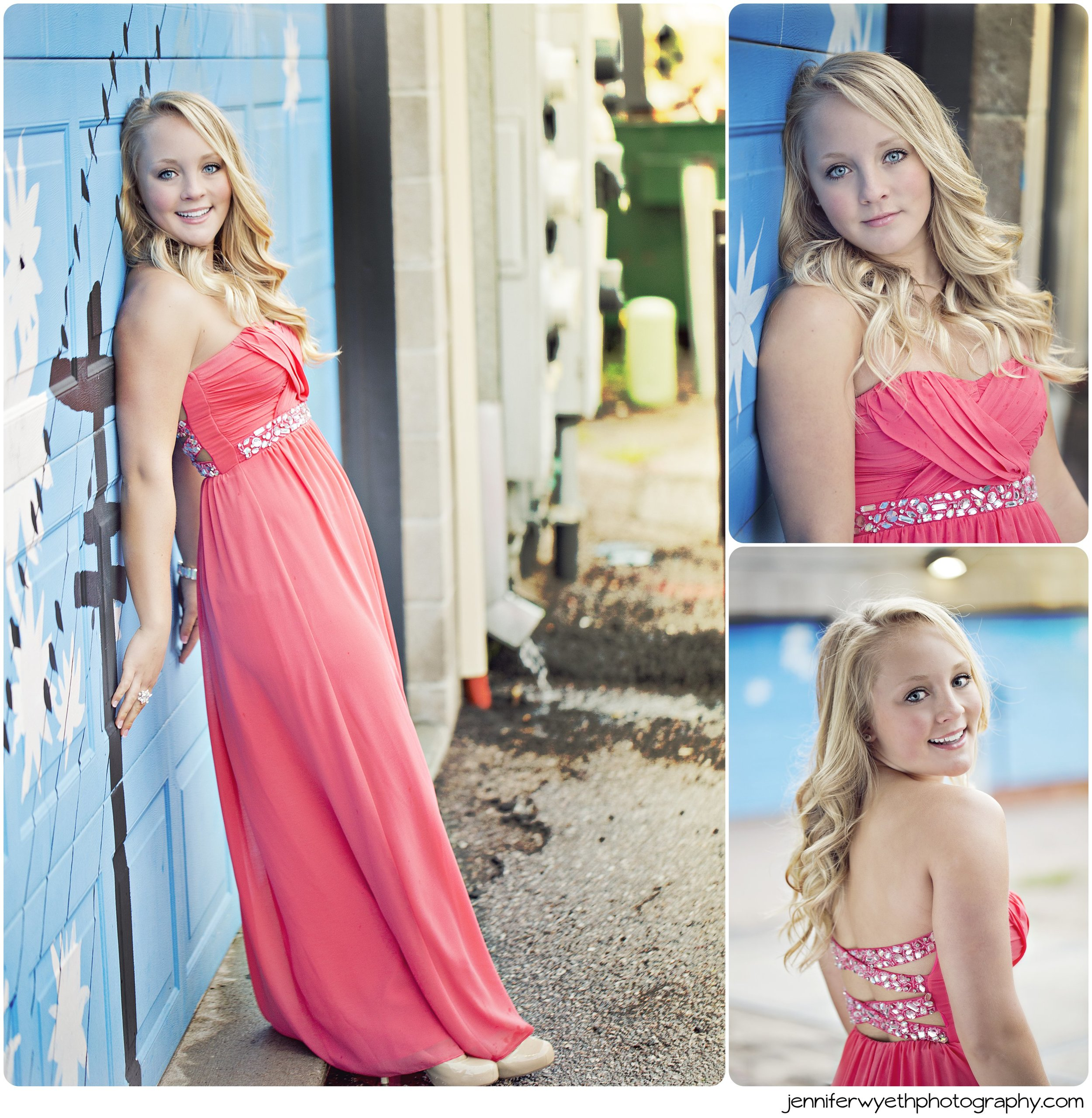 Beautiful blonde girl leans against blue garage in prom dress