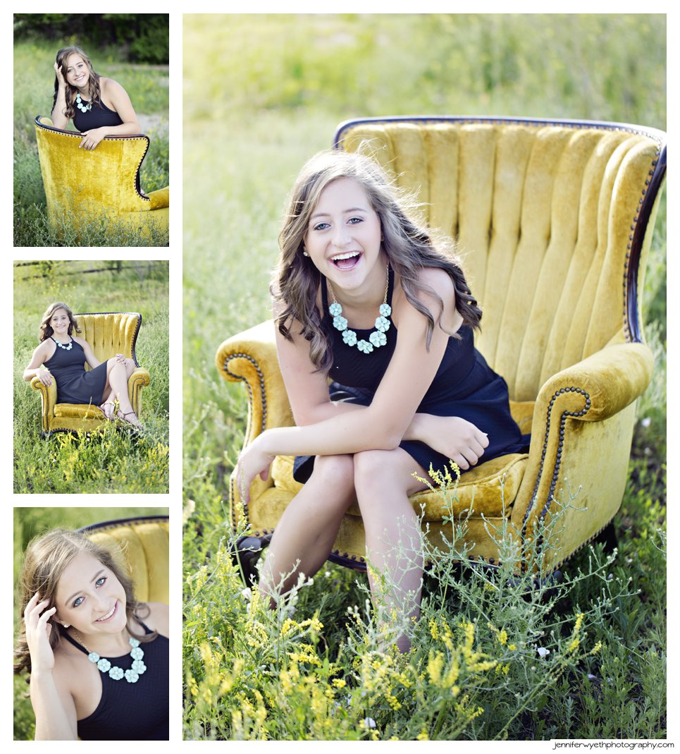 girl laughing in a yellow chair in a field