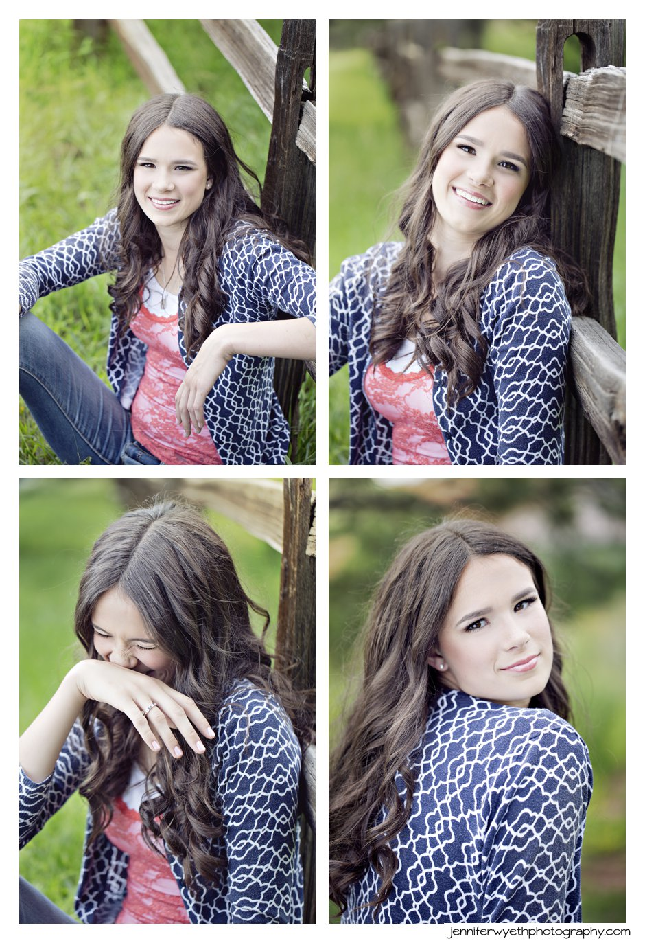 brunette sits against a fence and laughs for a picture