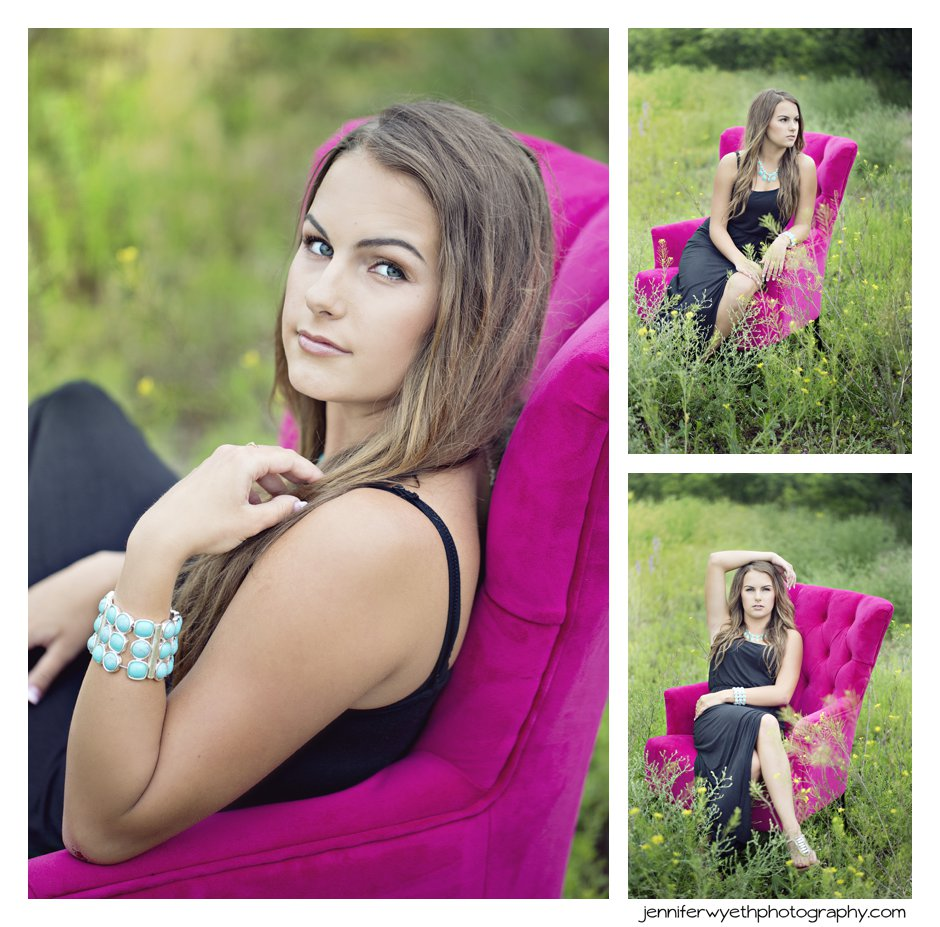 high school senior sits in hot pink chair in a field