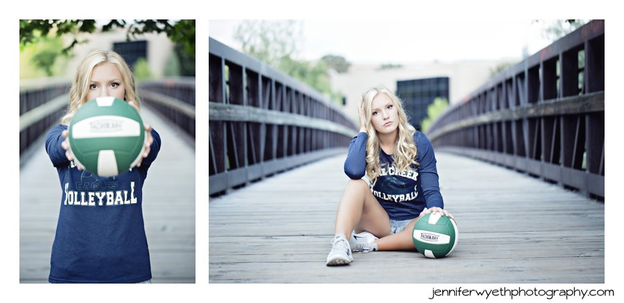 high school senior girl poses in her volleyball shirt and ball.