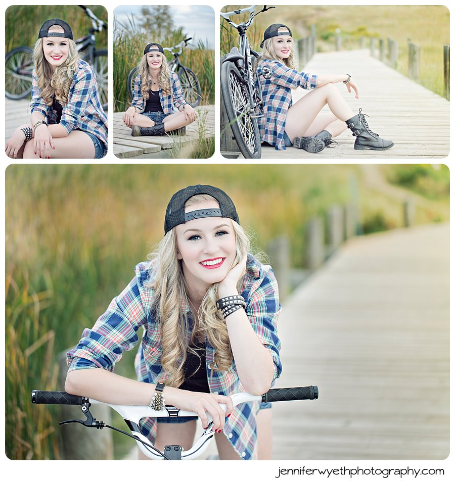 senior girl brings BMX bike to senior session and does tricks on it for photographer