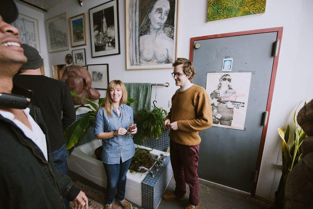 Hoar stands in his bathroom beside artworks of Deborah Masters . Photo: Randall Bellows III