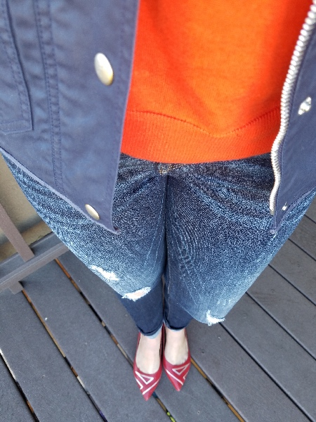 Stunning Style bold fall style. Navy utility jacket, orange sweater, read flats, destroyed jeans.  Lipsense 1x Purple Reign 1x Blu-red 1x Purple Reign Glossy gloss.