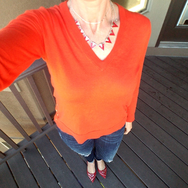 Stunning Style bold fall style. Orange sweater, read flats, destroyed jeans.  Lipsense 1x Purple Reign 1x Blu-red 1x Purple Reign Glossy gloss.