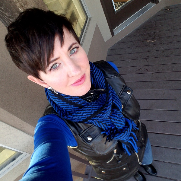 Stunning Style bold fall outfits. Cobalt tee, black leather moto vest, blue and black scarf, destroyed jeans, black moto boots. 1x Icicle 1x Kiss for a Cause 1x Icicle Glossy Gloss.