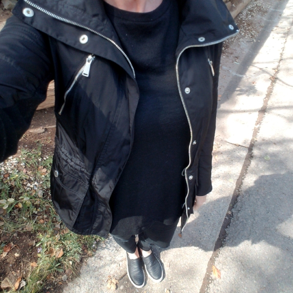 I'm wearing a tunic and destroyed skinny jeans, snake skin sneakers, and layered with a shinier black jacket with shiny silver hardware.
