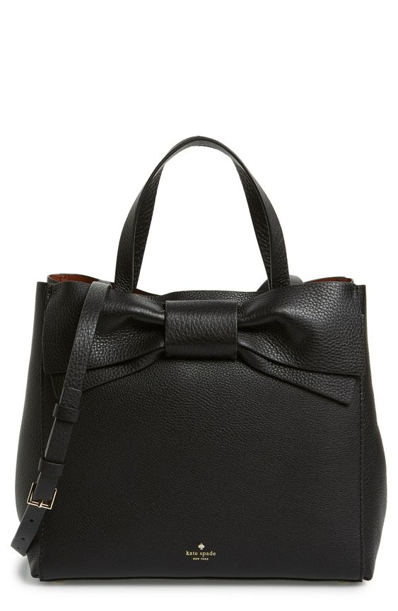 The large structured bow on this classic satchel bag is just the right amount of fun.