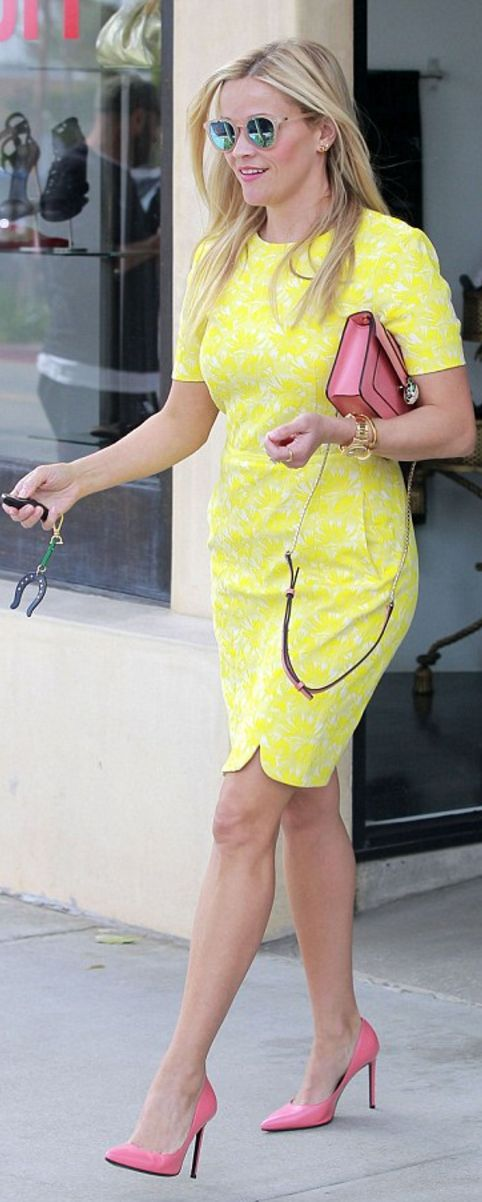 Imagine Reese's bag and shoes were punch-you-in-the-face-pink paired with this bold yellow floral print dress. It's bold, but fun. Light, but classic because of the structured lines of the dress, bag and shoes. Serious business, but ready for for a party after business is over.