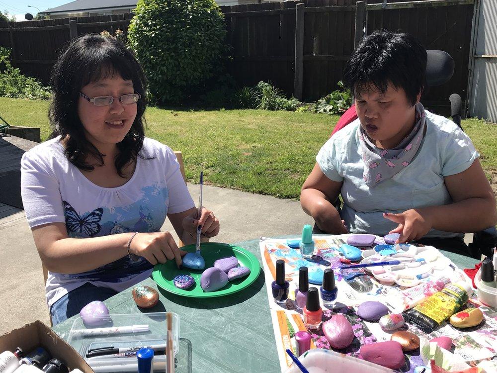 May and Batin enjoy painting rocks together.