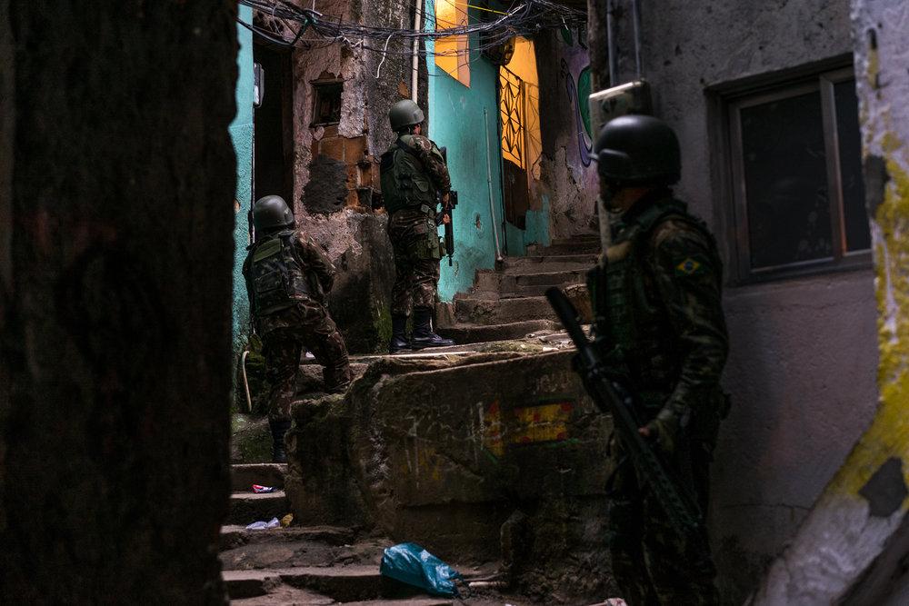 Members of Brazil's armed forces patrol Rocinha favela, Rio de Janeiro, June 9, 2018.