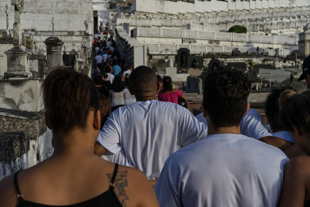 Family and friends gather to pay respect to Deivison Farias de Mouro, March 31 in Rio de Janeiro. (C.H. Gardiner)