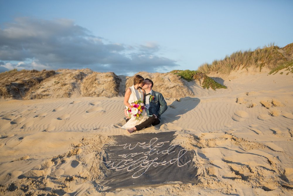 Photo by Samantha Josette Photography, Banner by Fete & Quill, Hair and Makeup by Brit Tarr Hair & Makeup, Dress from Something Bridal , Flowers by ME! Elopement in Grover Beach California.