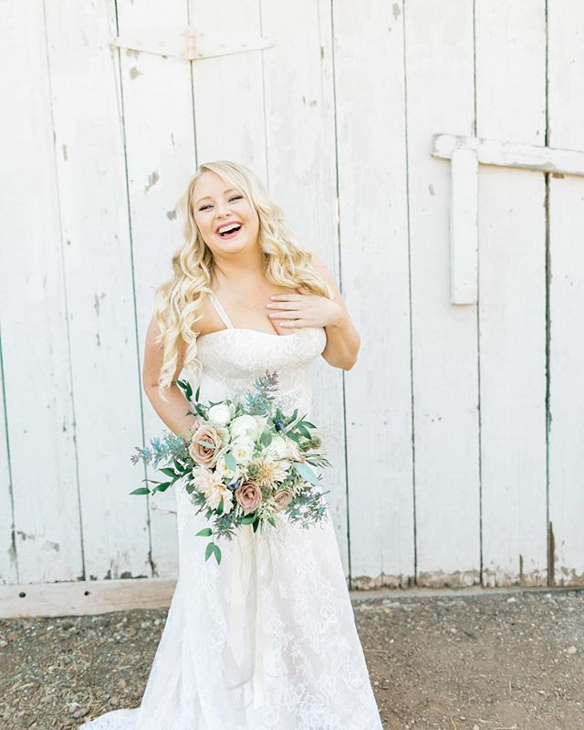 Now that I've stopped you in your scroll with this stunning bride. I mean can you even handle this beauty! @mo_tigue you not only were stunning but you truly represented exactly how a bride should feel and carry herself on her wedding day. You truly were on cloud nine and it showed. . . I don't know about you guys but when im around happy people ... I'm happy. It's contagious just like laughter. So if you are a bride just remember to have fun, laugh, smile and you better believe your groom and guests will have no choice other than to be happy with you. . . Okay friends, let me know in the comments something or someone that can always make you smile or laugh! . . Photographer @natalieschuttphotography // Video @storiestoldbyfilm // Venue @spreafico_farms // Florist @fluidbloom // Hair @btarr_hairmakeup // Makeup @candacemillermakeup // . . #happybride #stunningbride #gorgeousbride #laugh #smile #happyweddingday #caweddingplanner #30daysofsc #justlaugh #sloweddingplanner #sloweddingdesigner #justlaugh #whatmakesyoulaugh  #whatmakesyousmile #summerwedding #spreaficofarmswedding #slowedding #caweddingdesigner #californiaweddingplanner