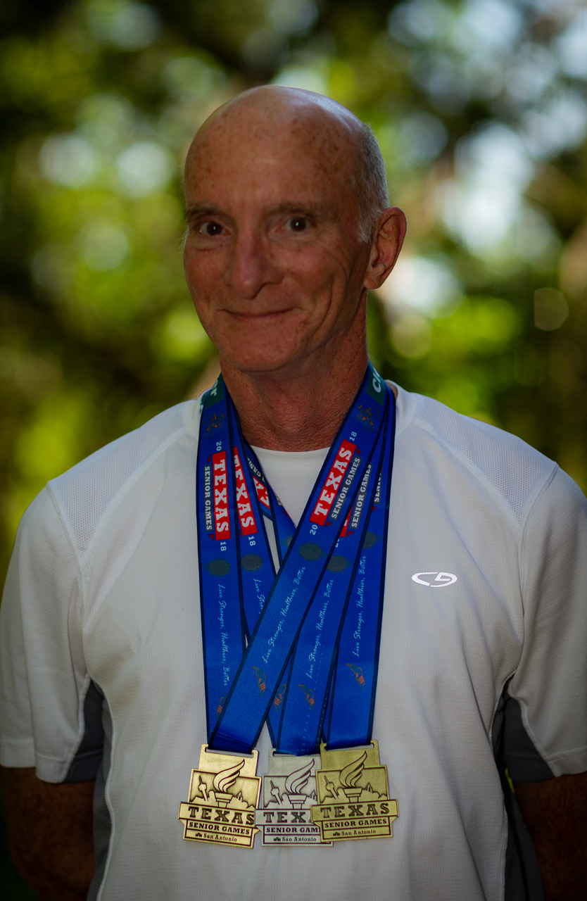 Taylor sporting his medals from the 2018 Texas Senior Games