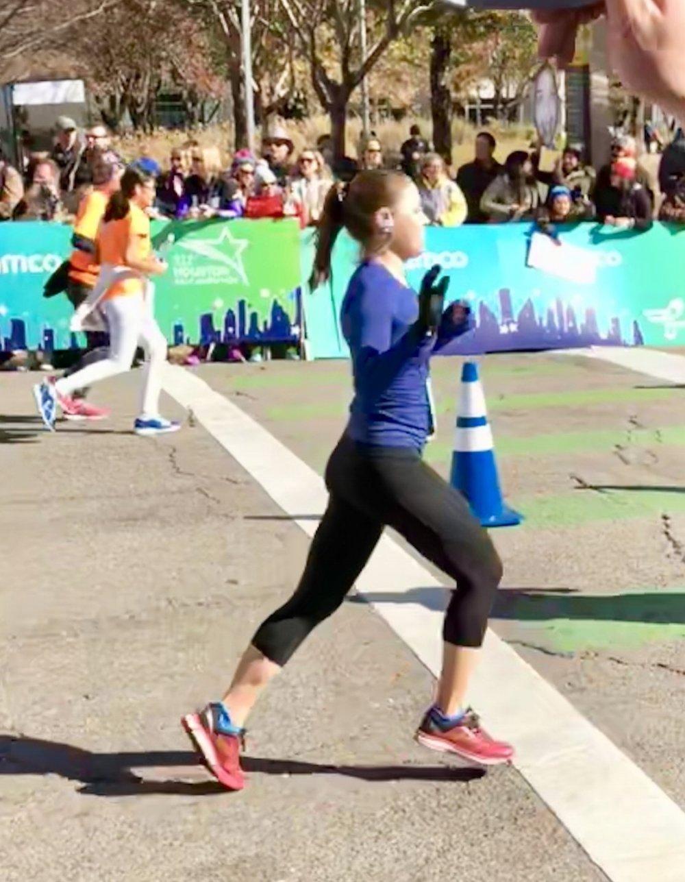 Krista crossing the finish line at the Houston Marathon 2018