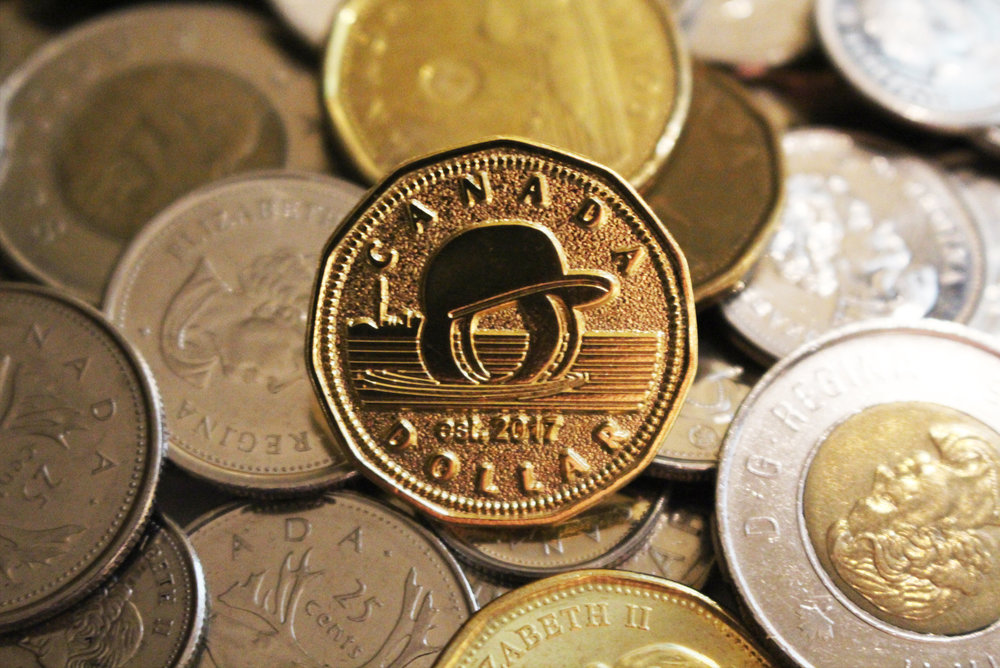 "The Over Your Head ""Loonie"" Pin    These pins aren't offered for sale - get yours free with every Over Your Head cap order."