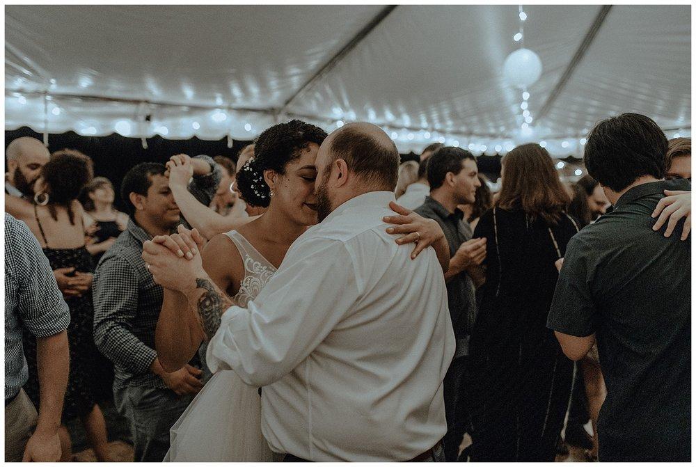 bride and groom sing at wedding