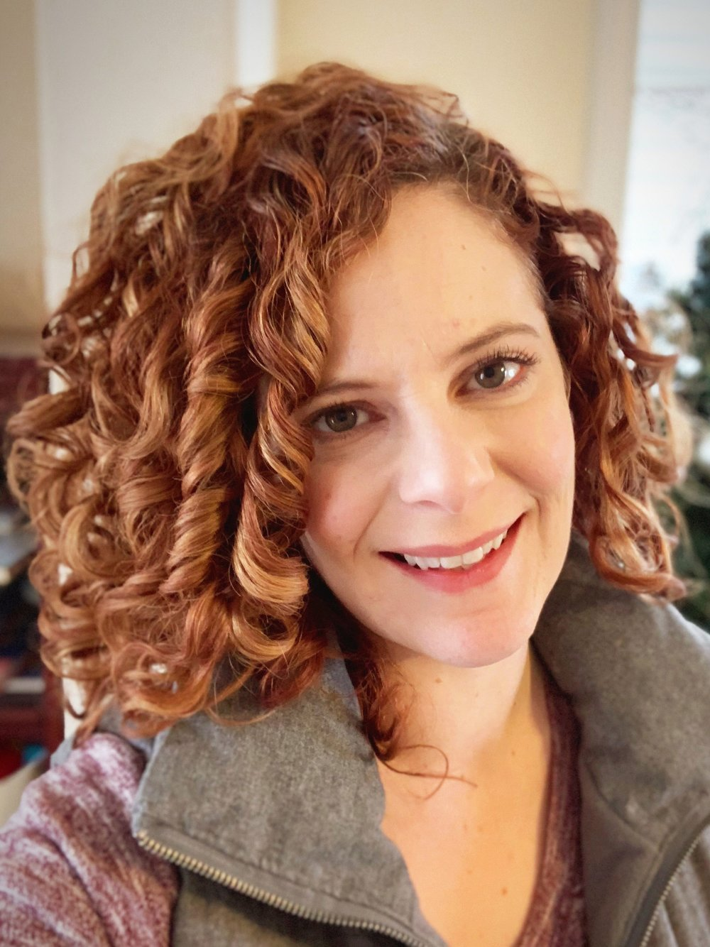 Sarah Vendittelli of Thoroughly Curly Designs, specializing in branding, print, and web design for creatively conscious small businesses.