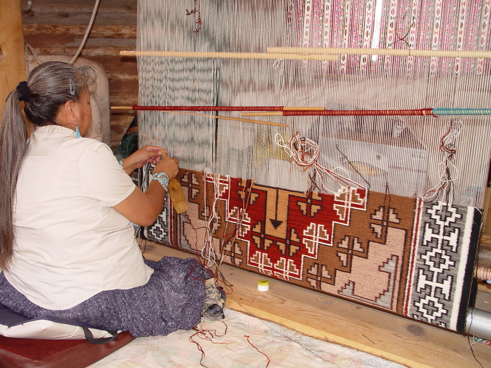 Hand knotted rug in process on the loom.