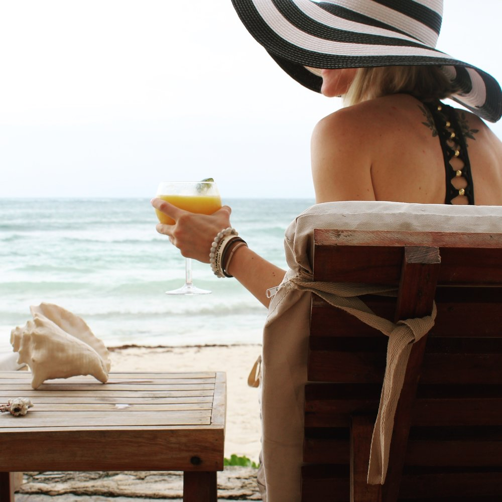 Sipping Mango Margaritas on the Beach in Tulum, Mexico | Thoughtfully Thrifted