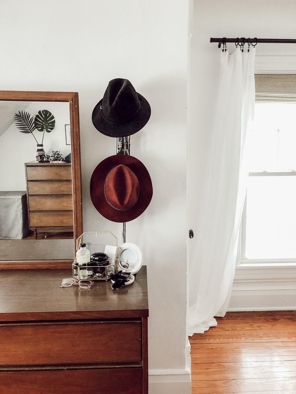 White Master Bedroom with Hats on the Wall | Miranda Schroeder House Tour
