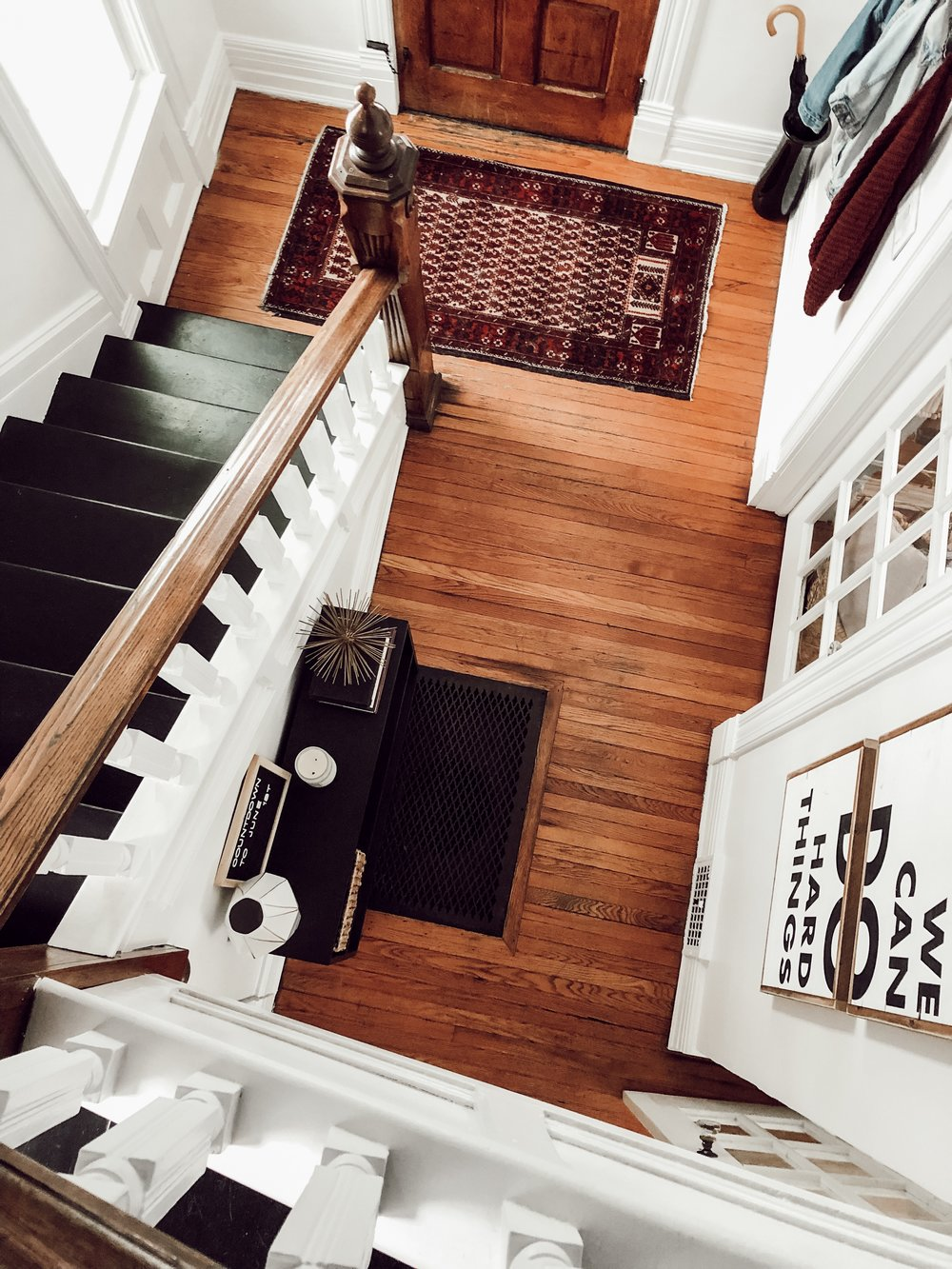 Staircase, Entryway, Front Door | White Master Bedroom with Hats on the Wall | Miranda Schroeder House Tour