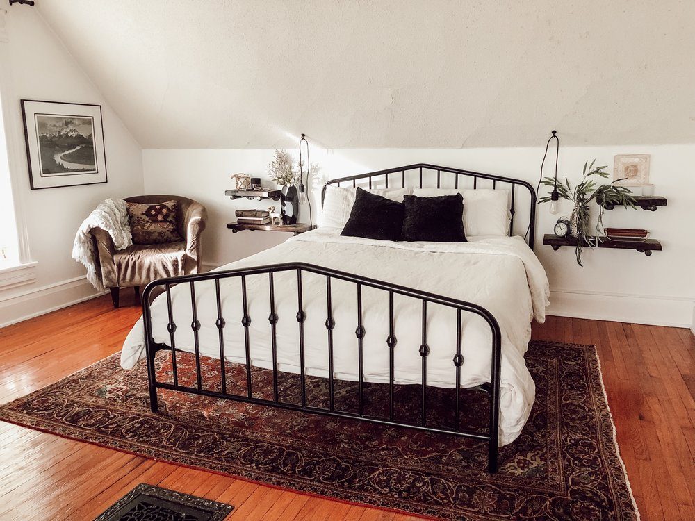 White Master Bedroom with Black Metal Bed & Persian Rug | Miranda Schroeder House Tour