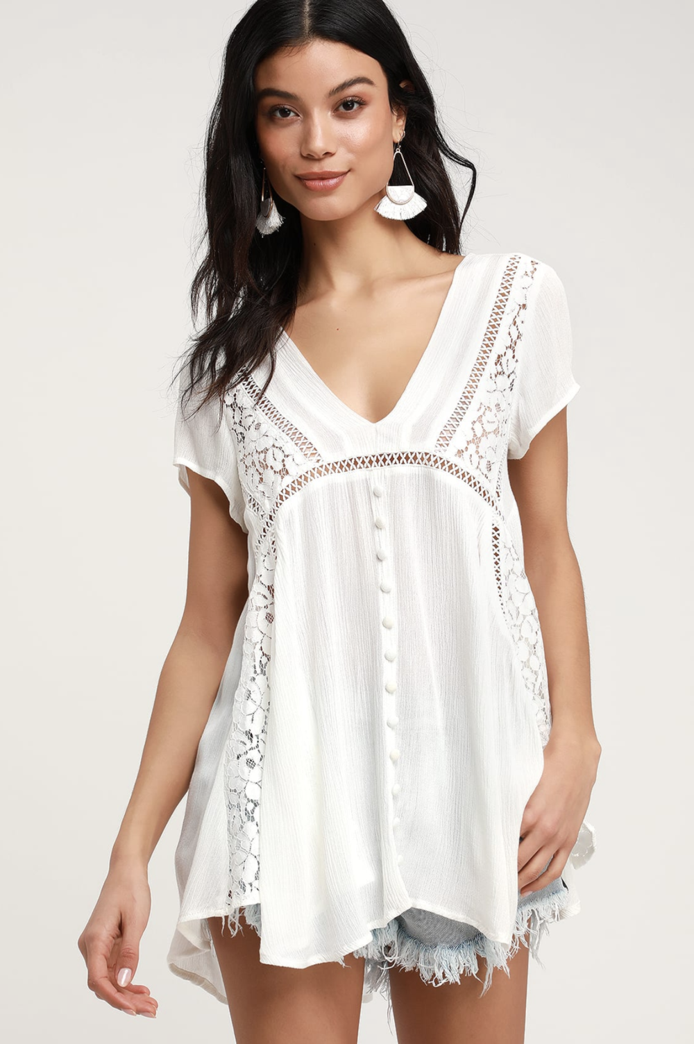 Stroll into style with the Sage the Label Take a Walk Ivory Sheer Lace Tunic Top! This sweet little number is shaped from lightweight and sheer woven fabric punctuated with floral and crochet lace across the flowy bodice and relaxed waist. A decorative button placket adds the final bit of detail to this lovely tunic top. Short cap sleeves and a V-neckline.