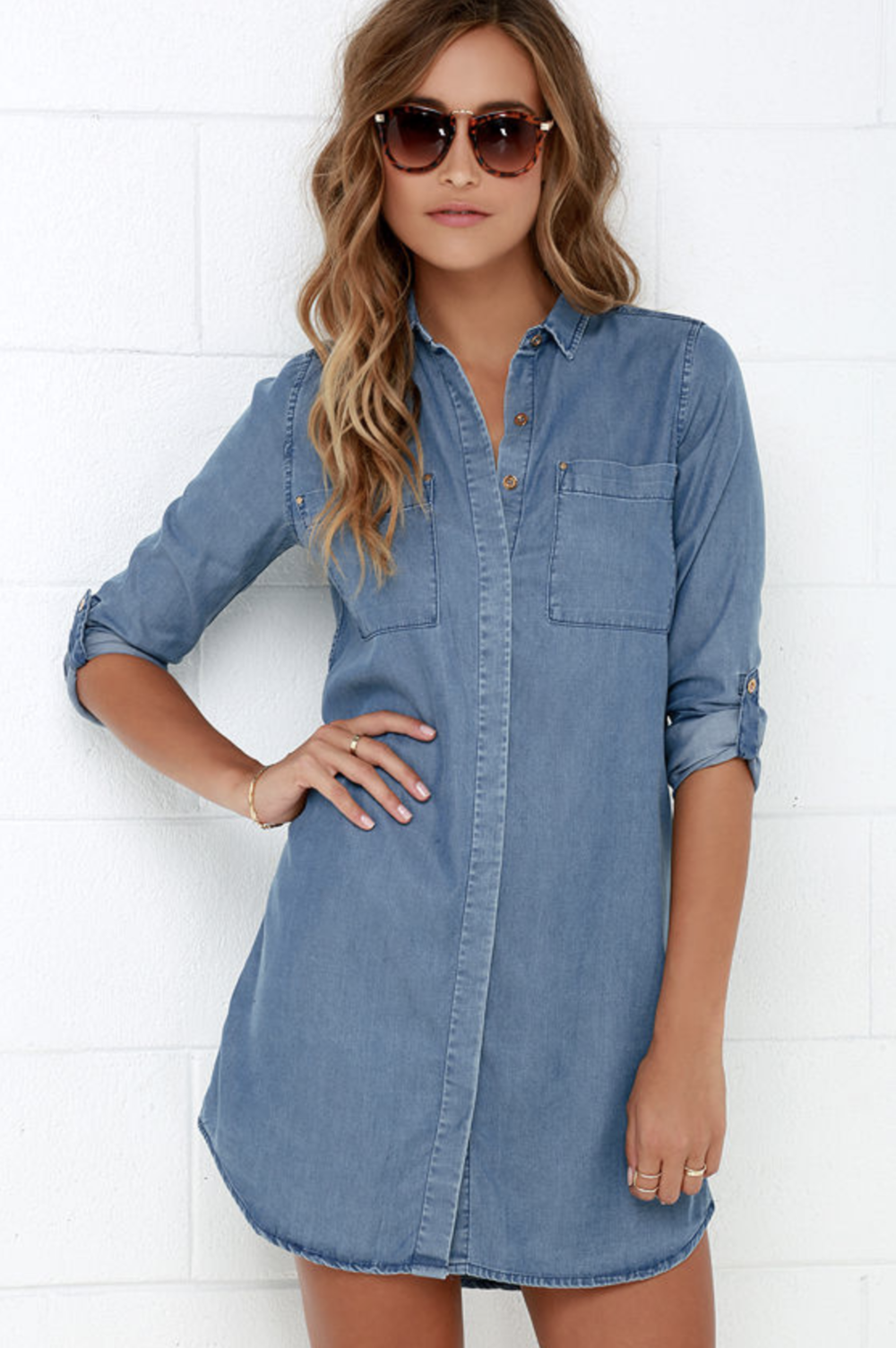 If you like your dresses cute and to the point, then you will adore our Lulus Shirt and Sweet Blue Chambray Shirt Dress! Soft and lightweight woven chambray is formed to a classic collared neckline, and long button-cuff sleeves, that can be worn rolled up thanks to button tabs. A hidden button placket joins the chic, shift bodice, framed by two patch pockets.