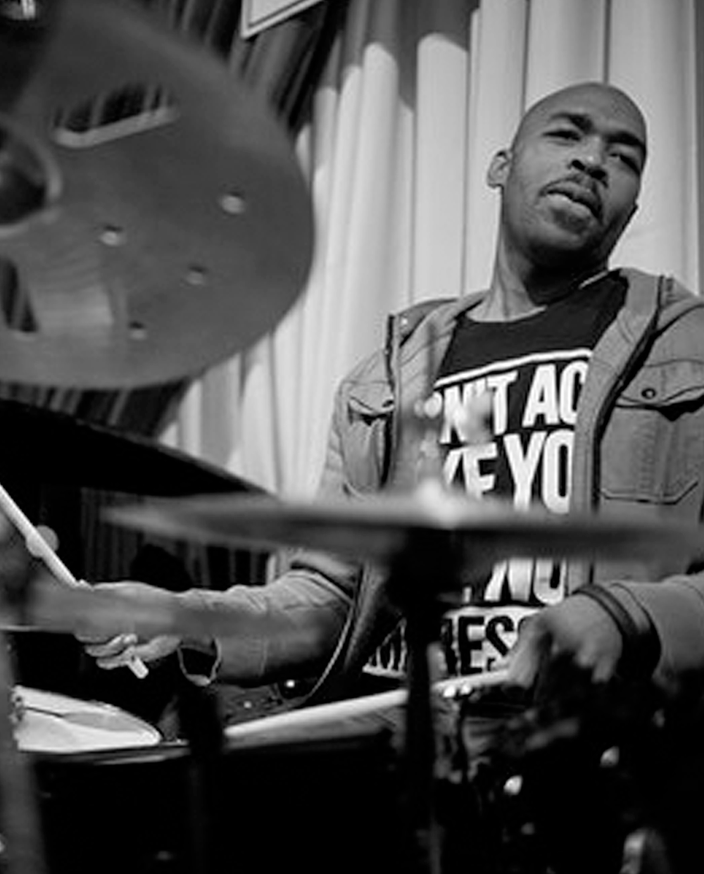 Eric Harland  Multi-Grammy nominated drummer, Eric Harland, has established himself as one of the premier jazz musicians of our time. He's collaborated with artists including John Mayer, Mariah Carey, Kevin Eubanks and Dispatch on over 300 recordings.  Eric's extensive resume includes founding his own production company, Eland Productions, and mentoring as an Artistic Director at SFJazz. He has been recognized in publications like The New York Times, The New Yorker and The Boston Globe.   Eric was born in Houston, Texas and is a graduate of the Manhattan School of Music.