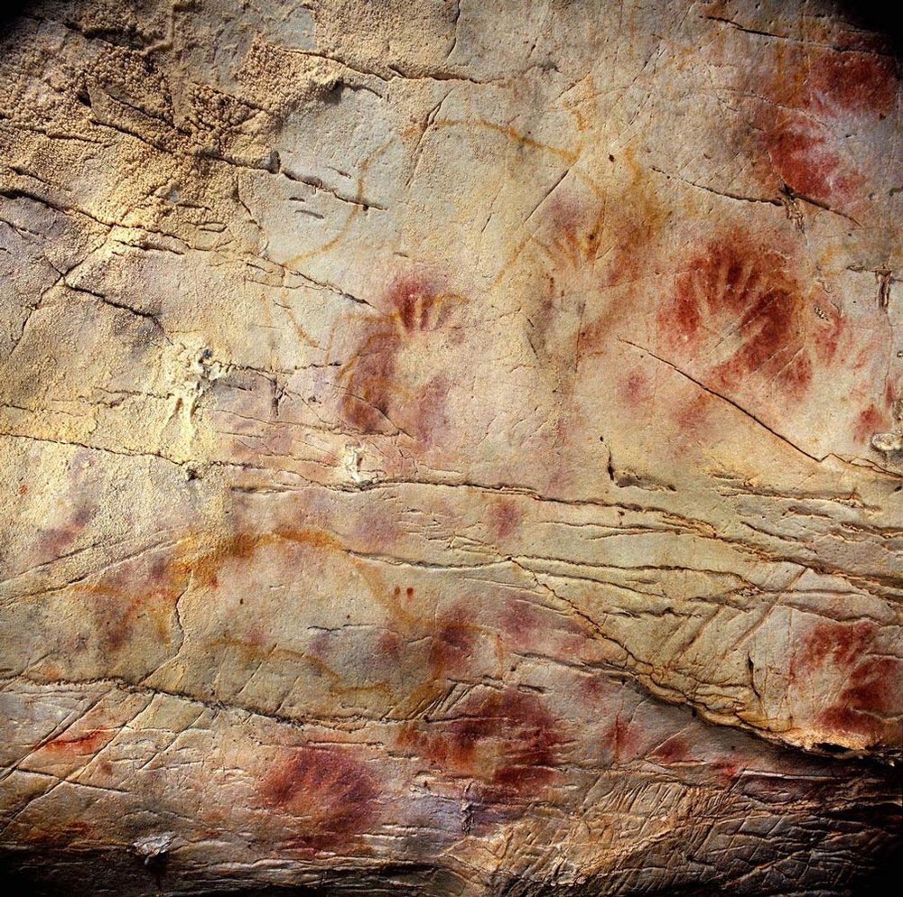 Panel of Hands, El Castillo Cave, Spain. A hand stencil has been dated to earlier than 37,300 years ago and a red disk to earlier than 40,600 years ago, (Image courtesy of Pedro Saura)