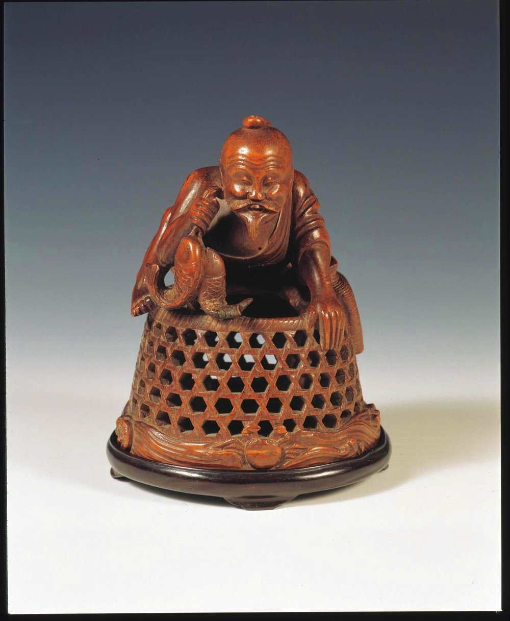 Bamboo carving of a Fisherman with his basket, Ming period(Image courtesy of Nanjing Museum/Nomad Exhibitions)