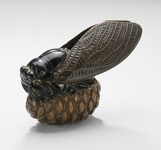 Hokufu, Japan. Cicada on Pine Cone, late 19th century Netsuke, Wood with lacquer staining (image courtesyof Collectionsonline.lacma)