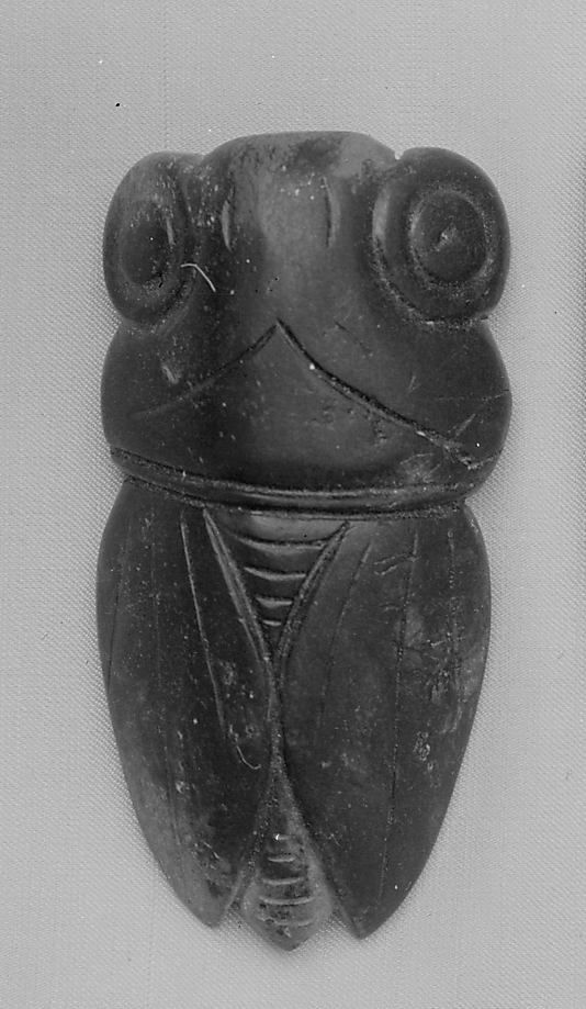 Jade Amulet, Han Dynasty Image courtesy of the Metroploitan Museum, New York)