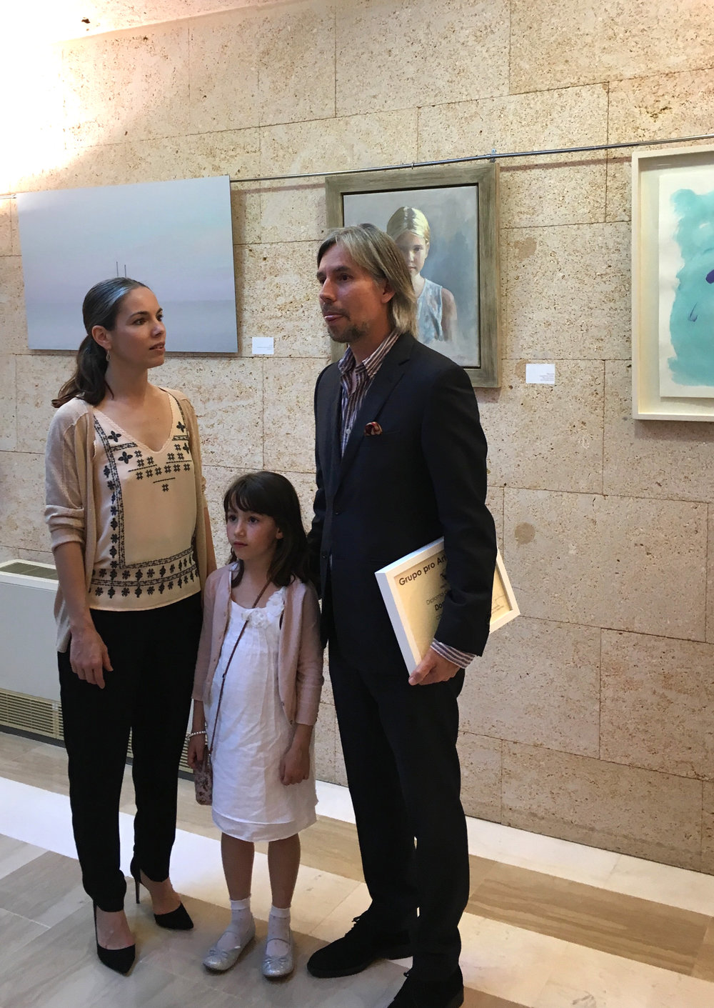 PortraitistJose Maria Fayos with his family at the opening reception