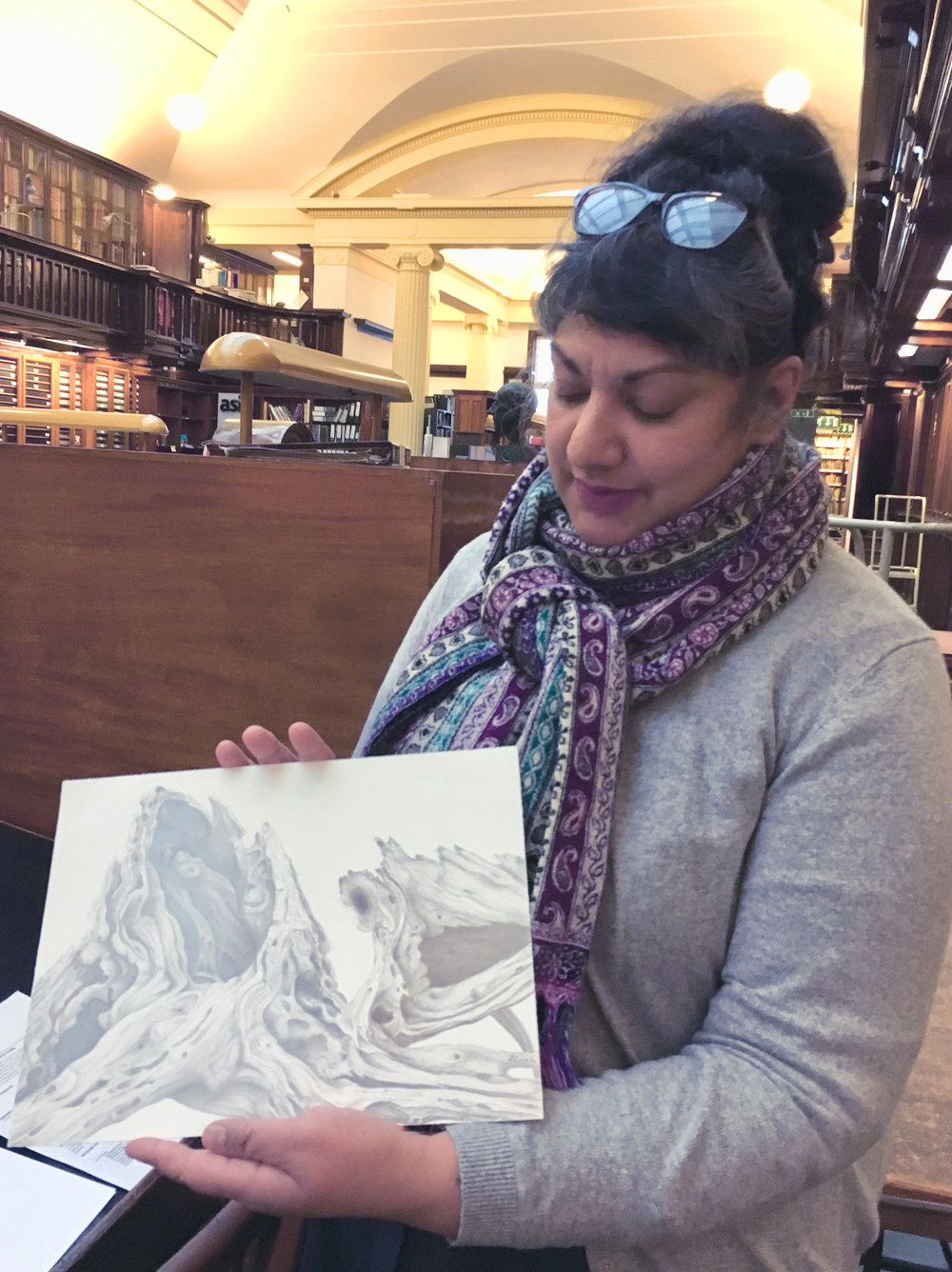 Dr. Jenny Ramkalawon holding my silverpoint drawing,  T  he Weathered Cedar