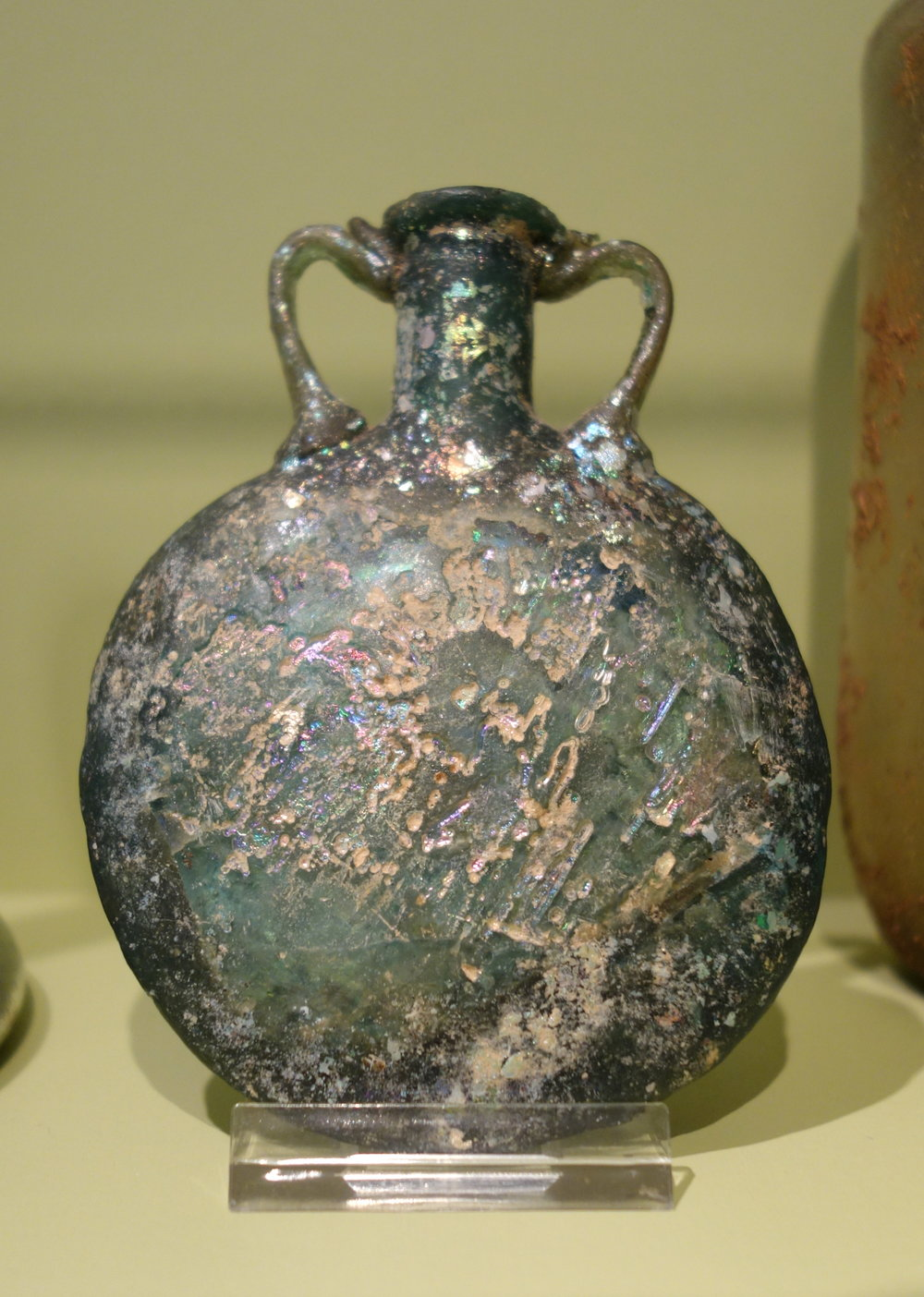 "Canteen Flask  ,Mediterranean, Eastern, 3th century, 3rd-4th century glass. Overall: 3 3/4"" x 2 7/8"" x 7/8"". (Image courtesy of the Huntington Museum of Art)"