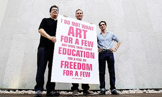 Artists Mark Wallinger, left, David Shrigley and Jeremy Deller, right, lobby cent cuts in arts funding, in London, September 2010. Photograph: Alastair Grant / AP