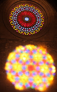 The rose window's light cast on the opposite wall of the Cathedral, Palma de Mallorca