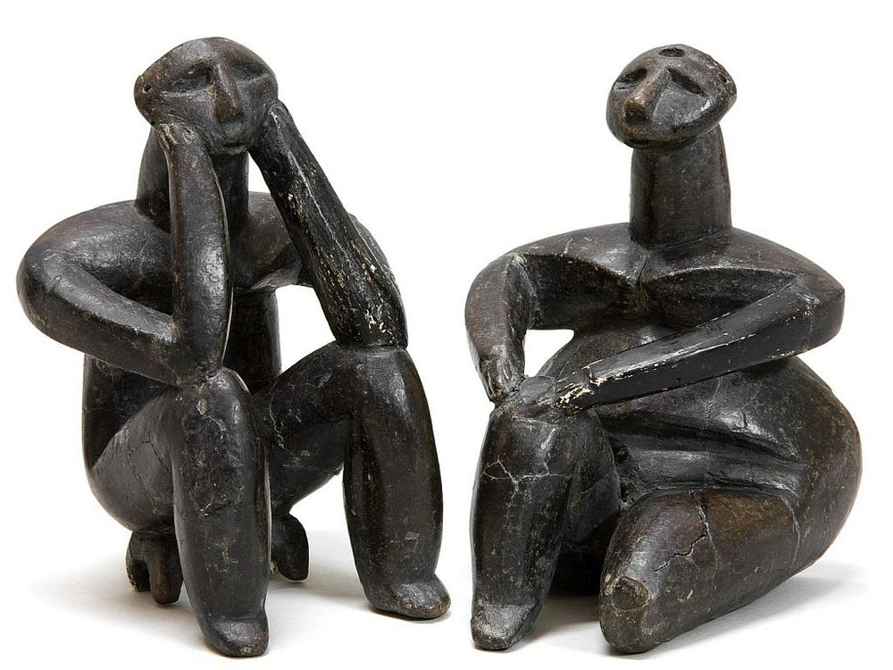 """Thinker of Cernavoda"" and ""Woman of Hamangia""; Romania, 5000 BC, (Image courtesy of the National History Museum, Bucharest.)"
