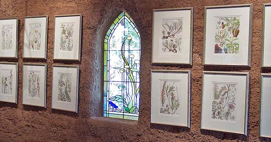 The Chapel of Flowers at Swallow's Welcome Art Studio, a chapel built with mud bricks by Patricia Negus and her husband, Tim, where she displays the original watercolours illustrating the book,  Wildflowers of Western Australia. ( Image courtesy of Cape to Cape Publishing).