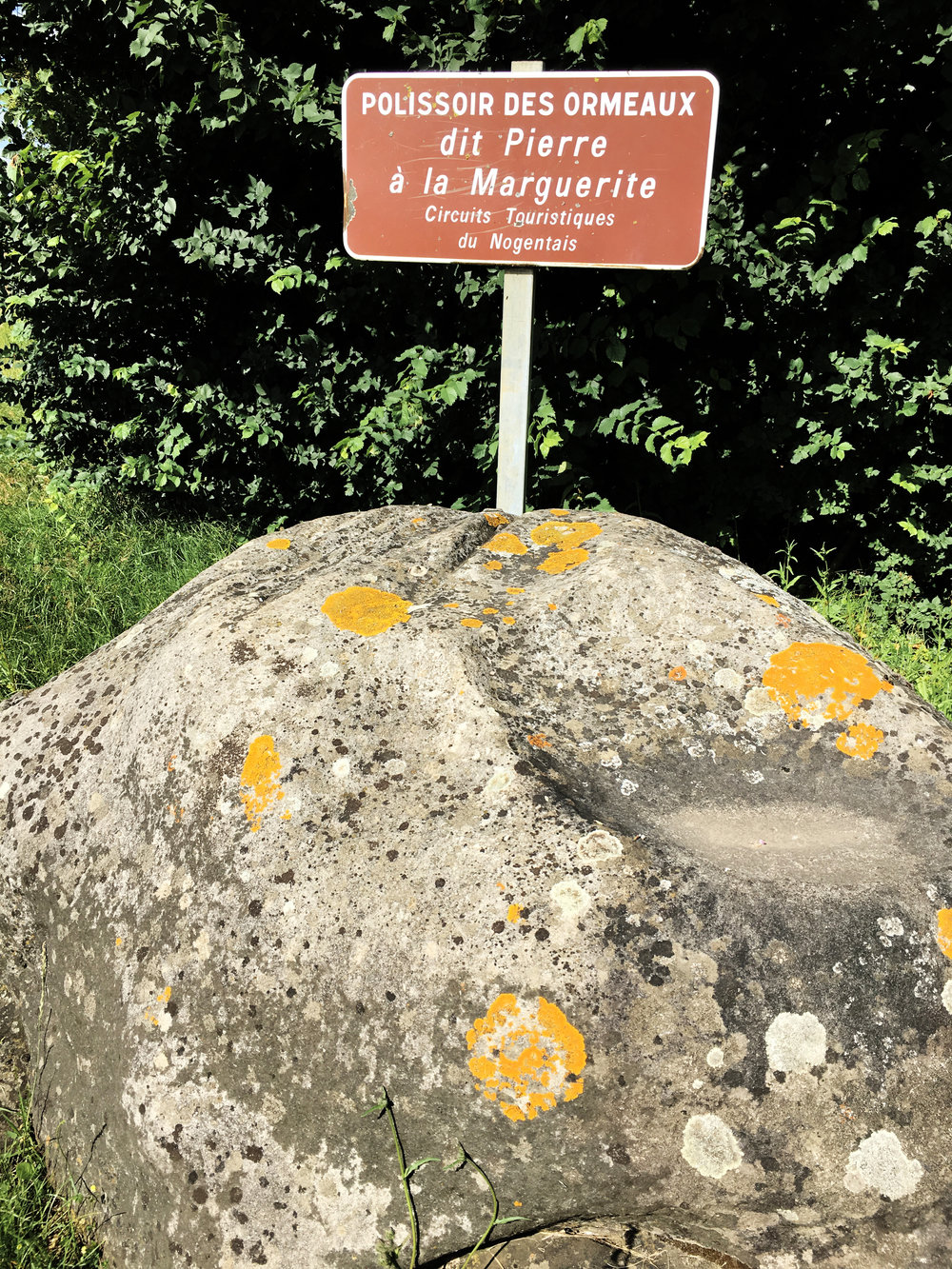 The Neolithic grinding stone at the entrance to Tremblay village (photograph J. Cook)