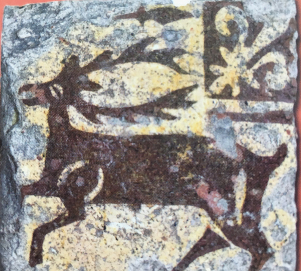 "A medieval tile about hunting in the Musée Saint Loup, Troyes (image in catalogue ""Carreaux de Pavement"").  With a stag, such as this one, the rider dismounted before he killed the animal, part of the hunting ritual."