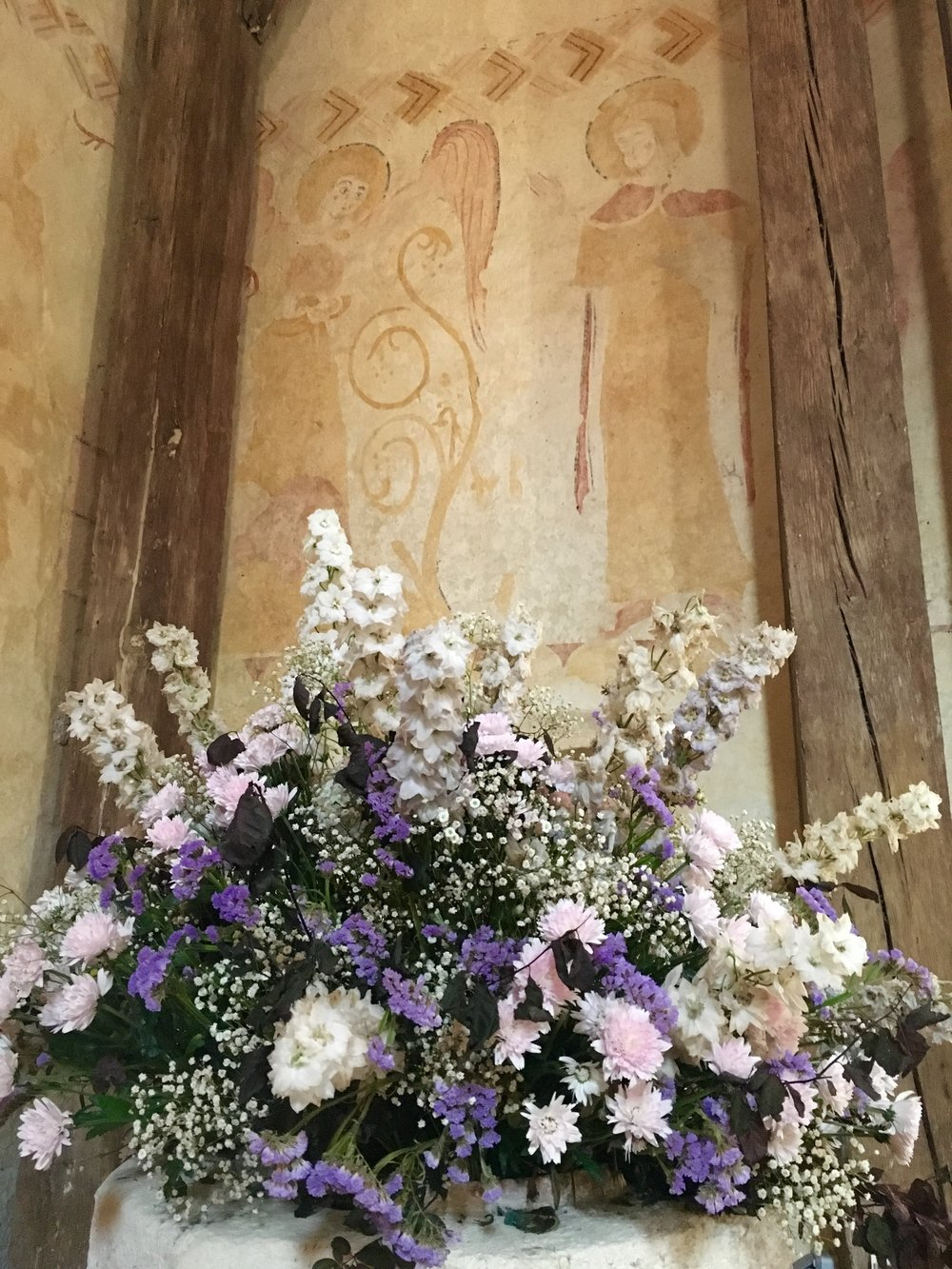 Fresh flowers graced Eglise St. Pierre the day we visited. Above, the Annunciation in a 12th century fresco. (photograph J. Cook)