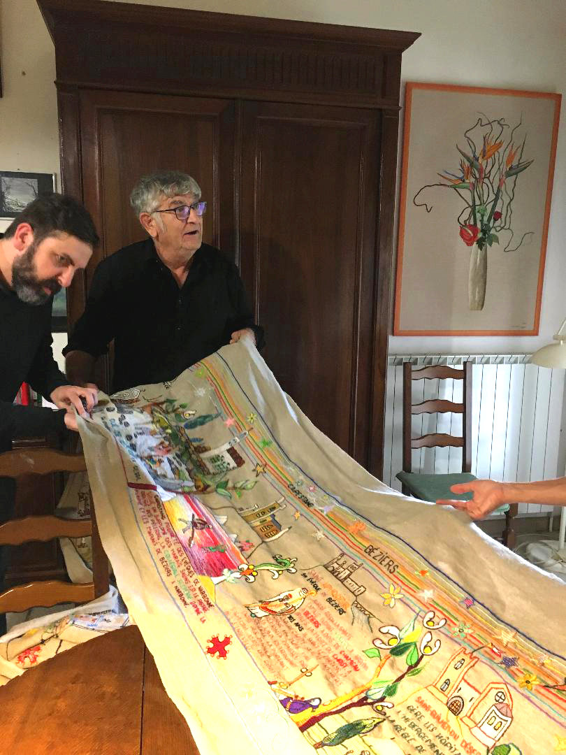Alain Dodier explaining the Pilgrims' Route panel to Gregory Mackay and other artists. (Photography J. Cook)