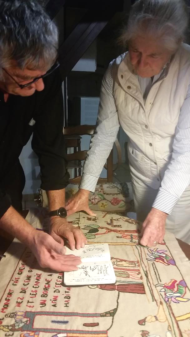 Alain Dodier explaining to Jeannine Cook his initial drawing process, long before a design is laid out on the linen panel, ready for embroidering. (Photograph courtesy of Eloise Caleo)