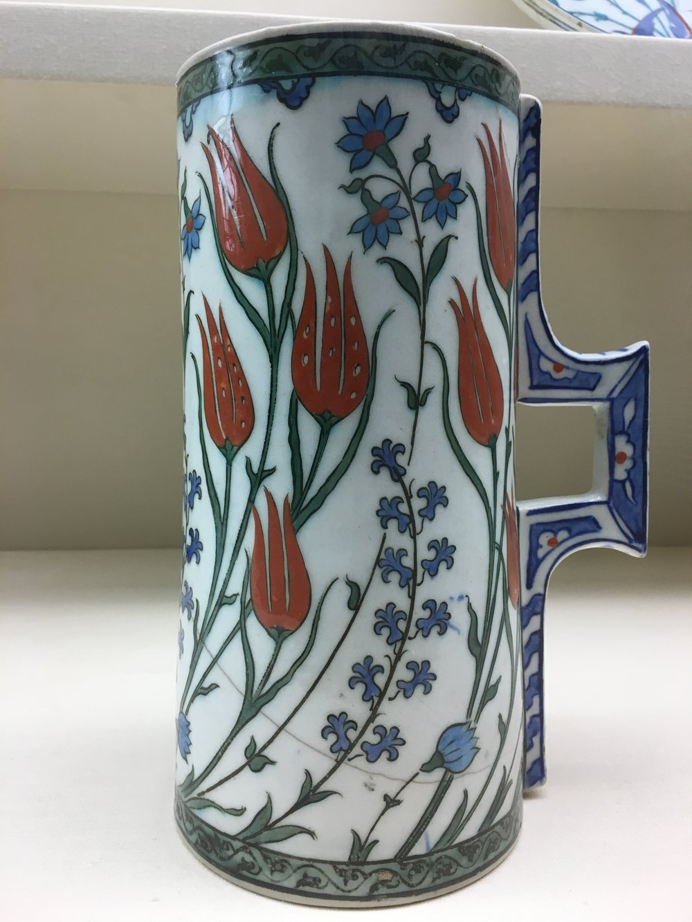Red tulips on a ca. 1575 Iznik Turkish tankard from the Ottoman period, stonepaste, painted under the glaze. In the Museu Calouste Gulbenkian, Lisboa. (Photograph J. Cook)